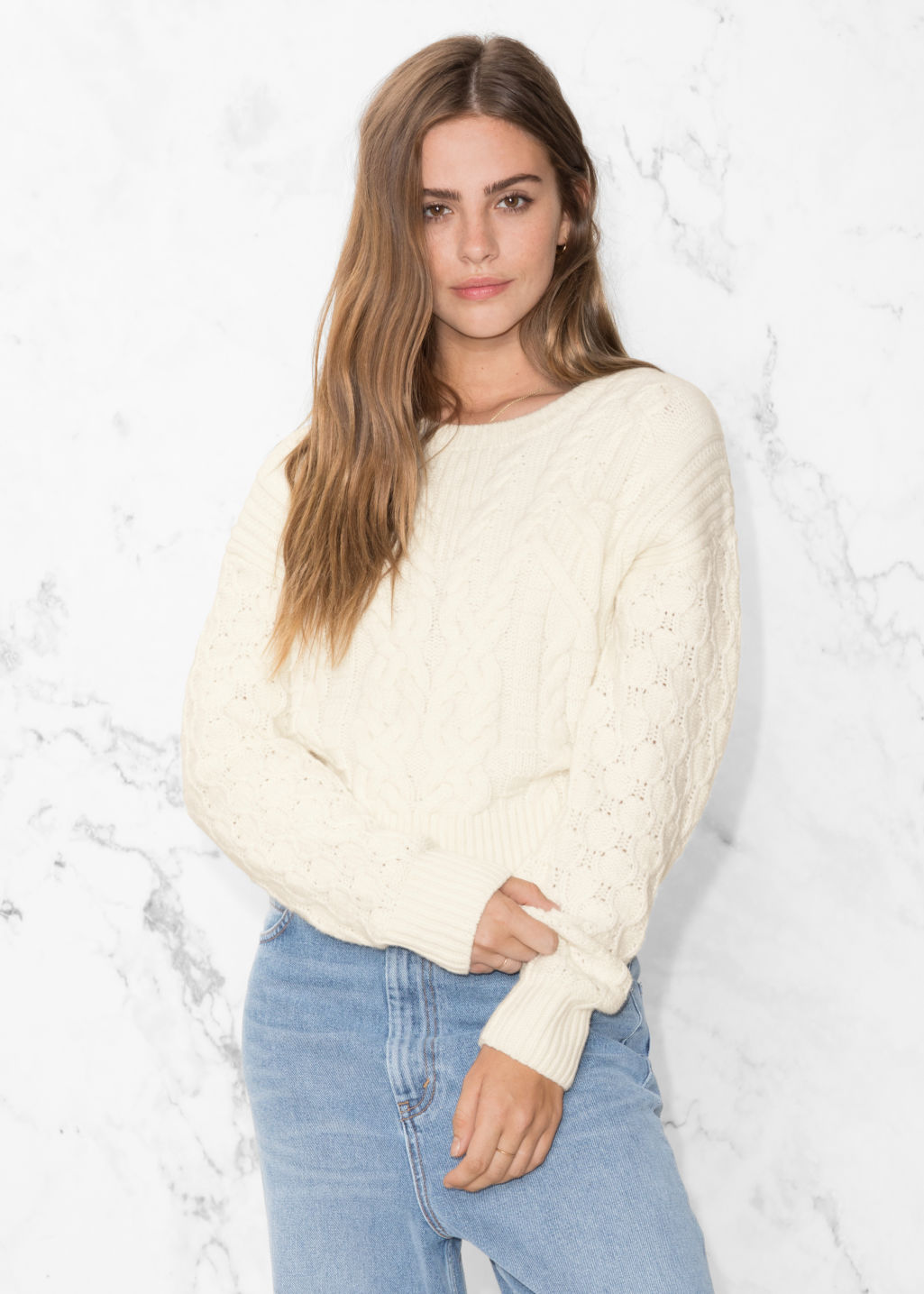 Model front image of Stories cable knit sweater in white