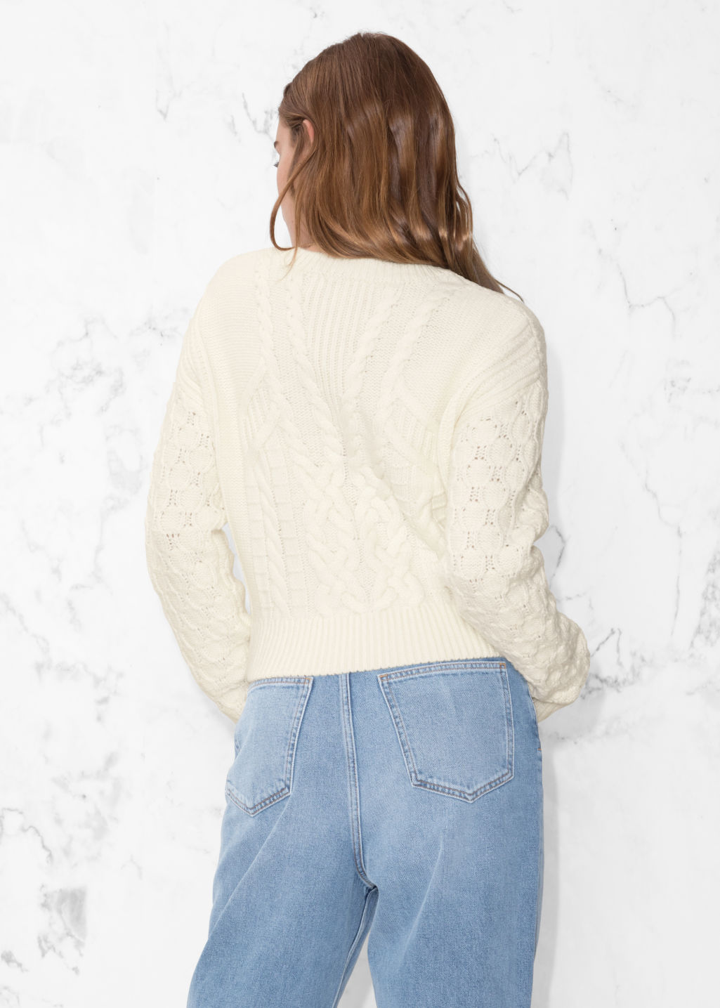 Model back image of Stories cable knit sweater in white