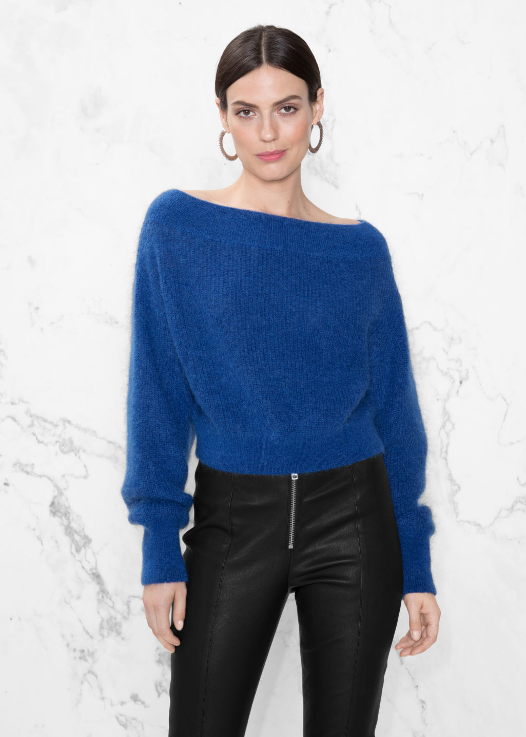 Model front image of Stories knit off-shoulder sweater in blue
