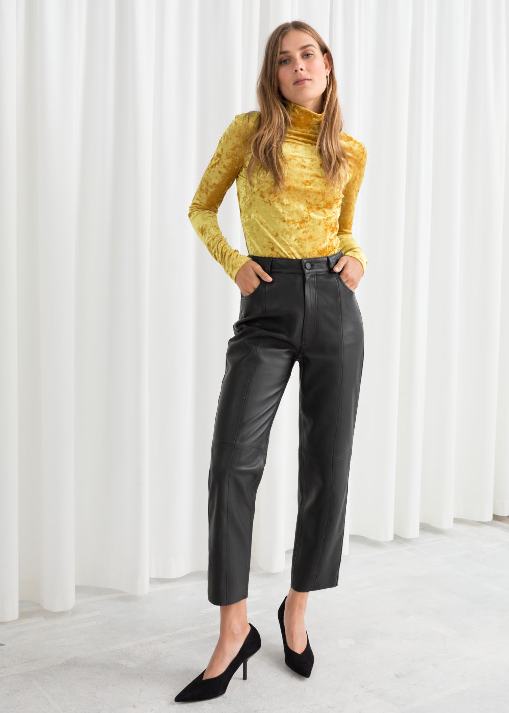 Model front image of Stories leather trousers in black