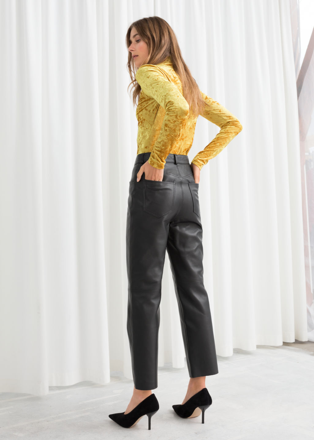 Model back image of Stories leather trousers in black
