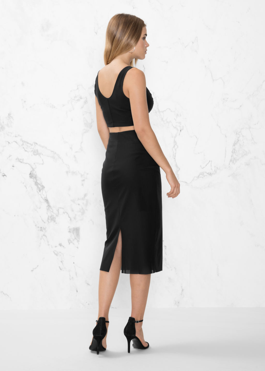 Model back image of Stories slit pencil skirt in black