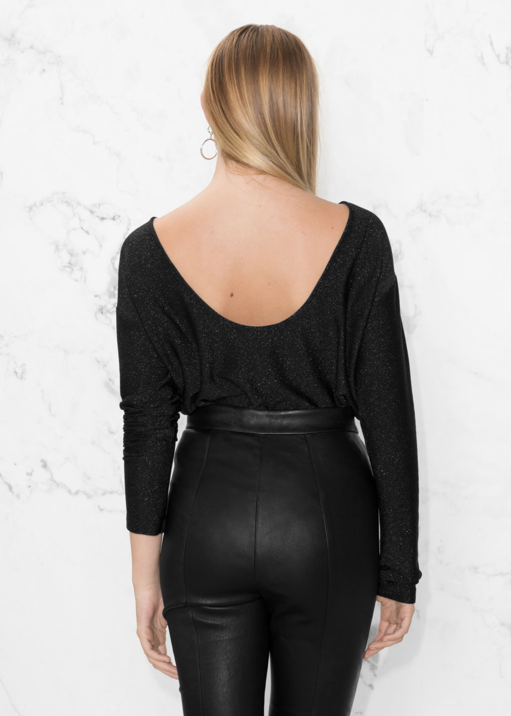 Model back image of Stories scooped back top in black