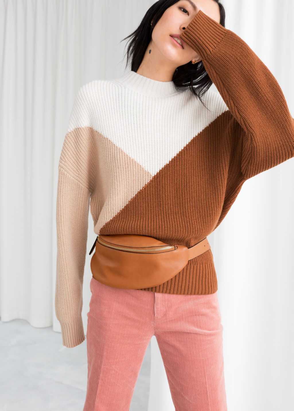 Model front image of Stories colour block sweater in beige
