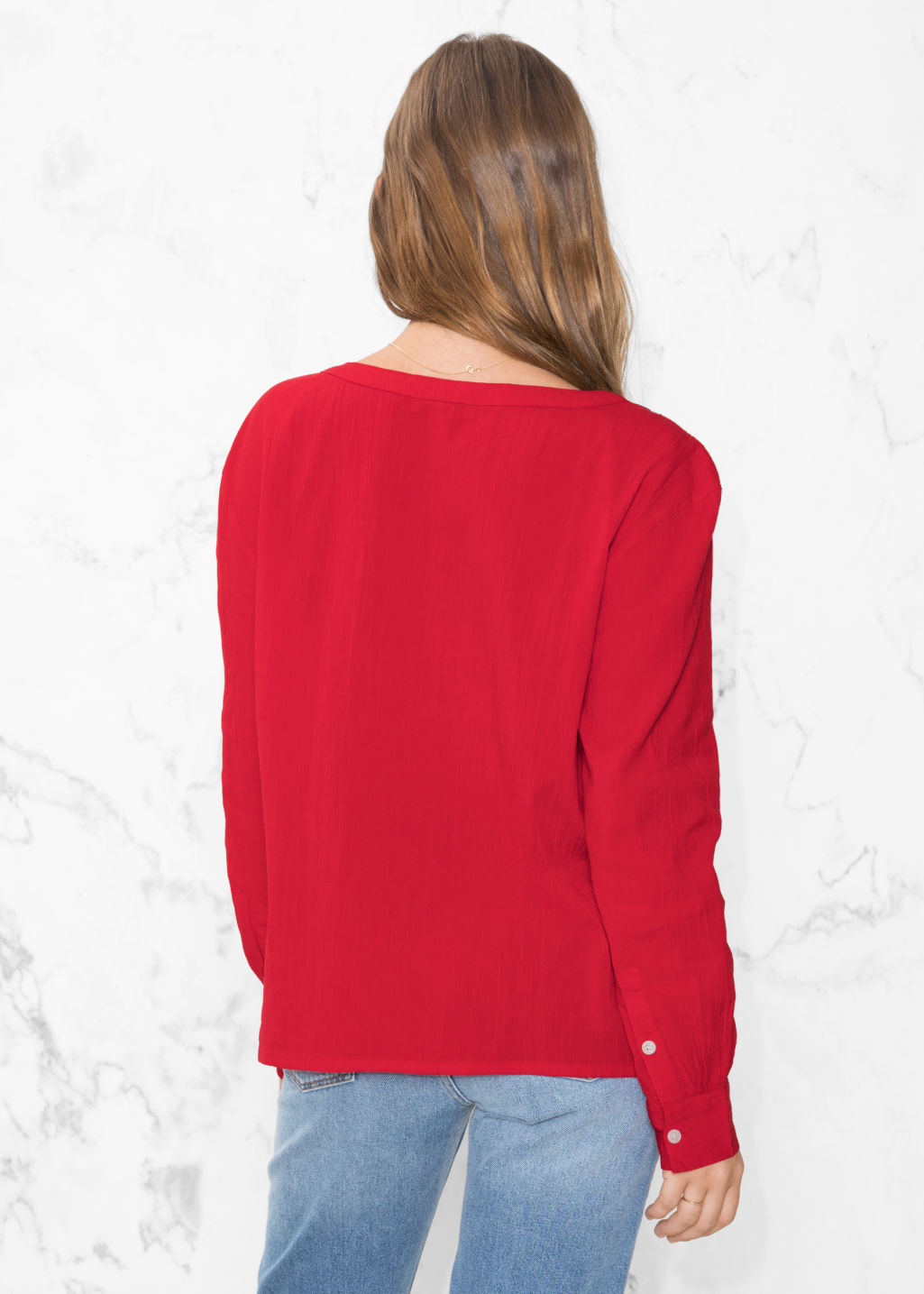 Model back image of Stories v-neck blouse in red