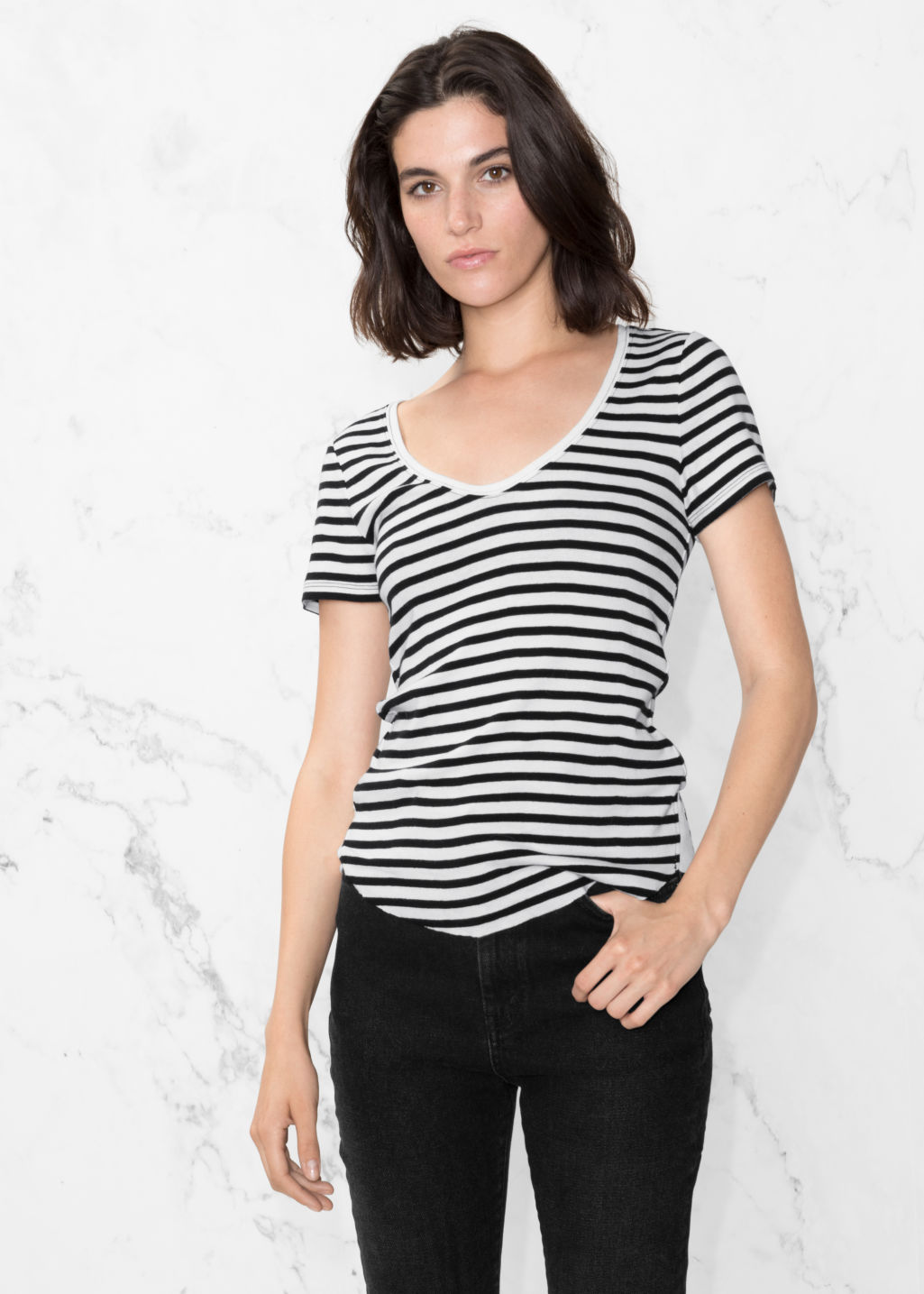 Model front image of Stories v-neck top in white