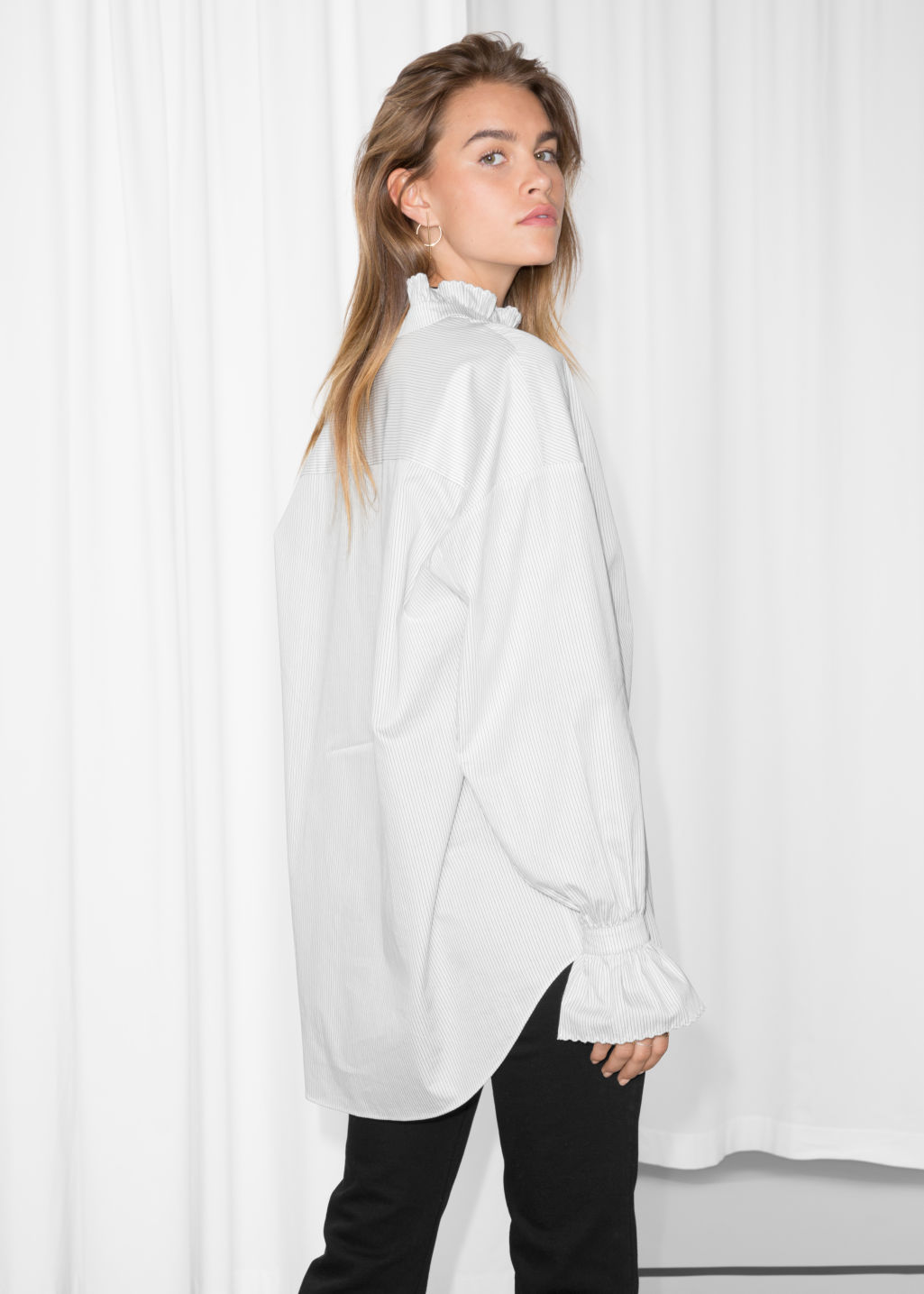 Model back image of Stories scallop edge blouse in white