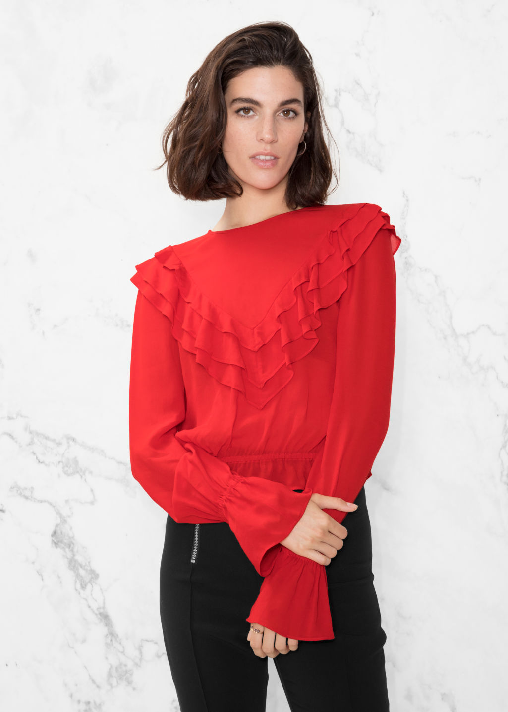 Model front image of Stories ruffle blouse in red