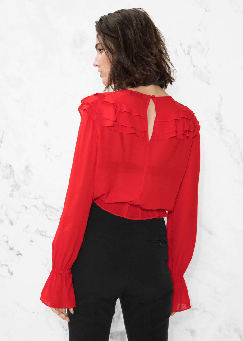 Model back image of Stories ruffle blouse in red