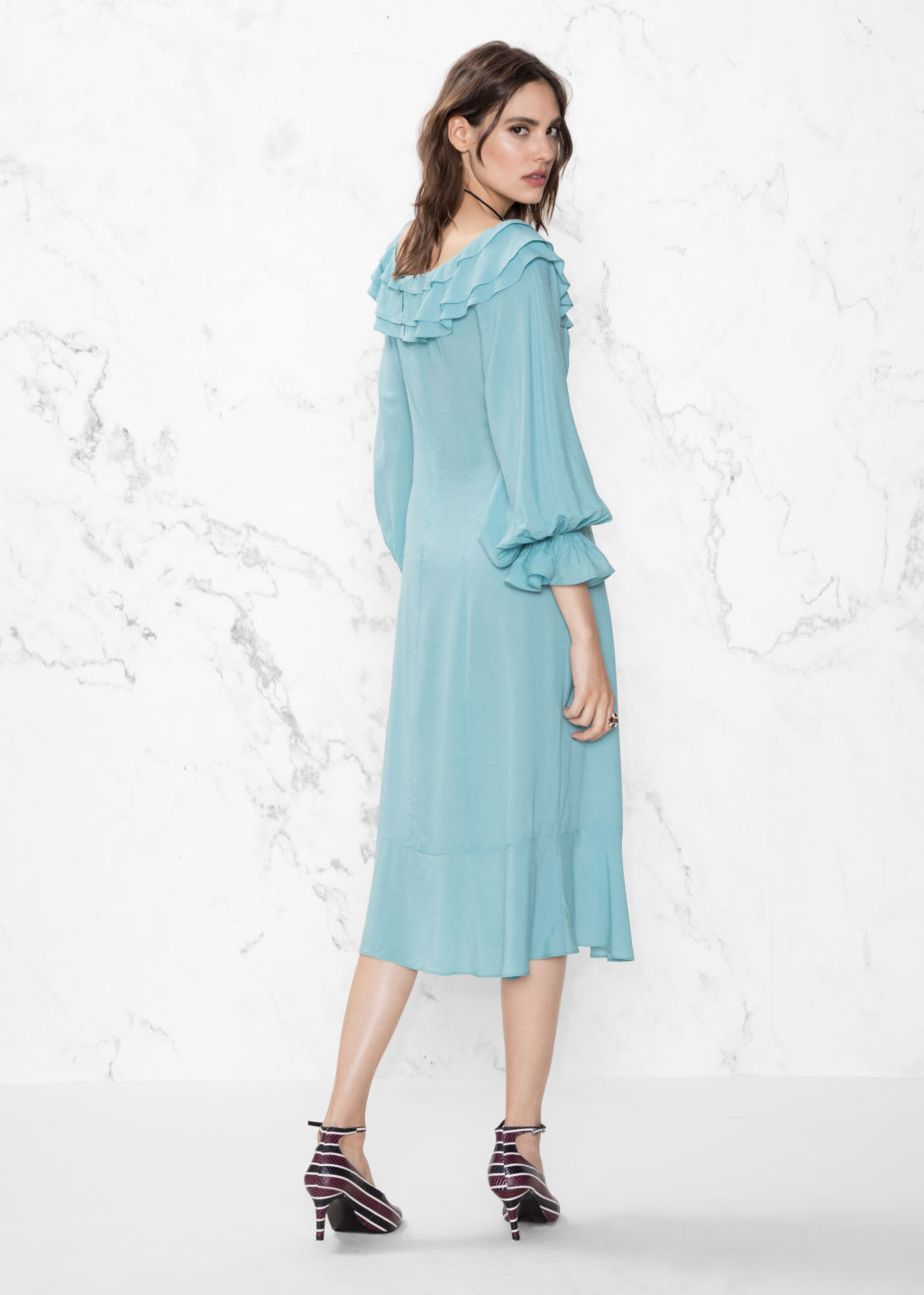 Model back image of Stories layered frill dress in turquoise