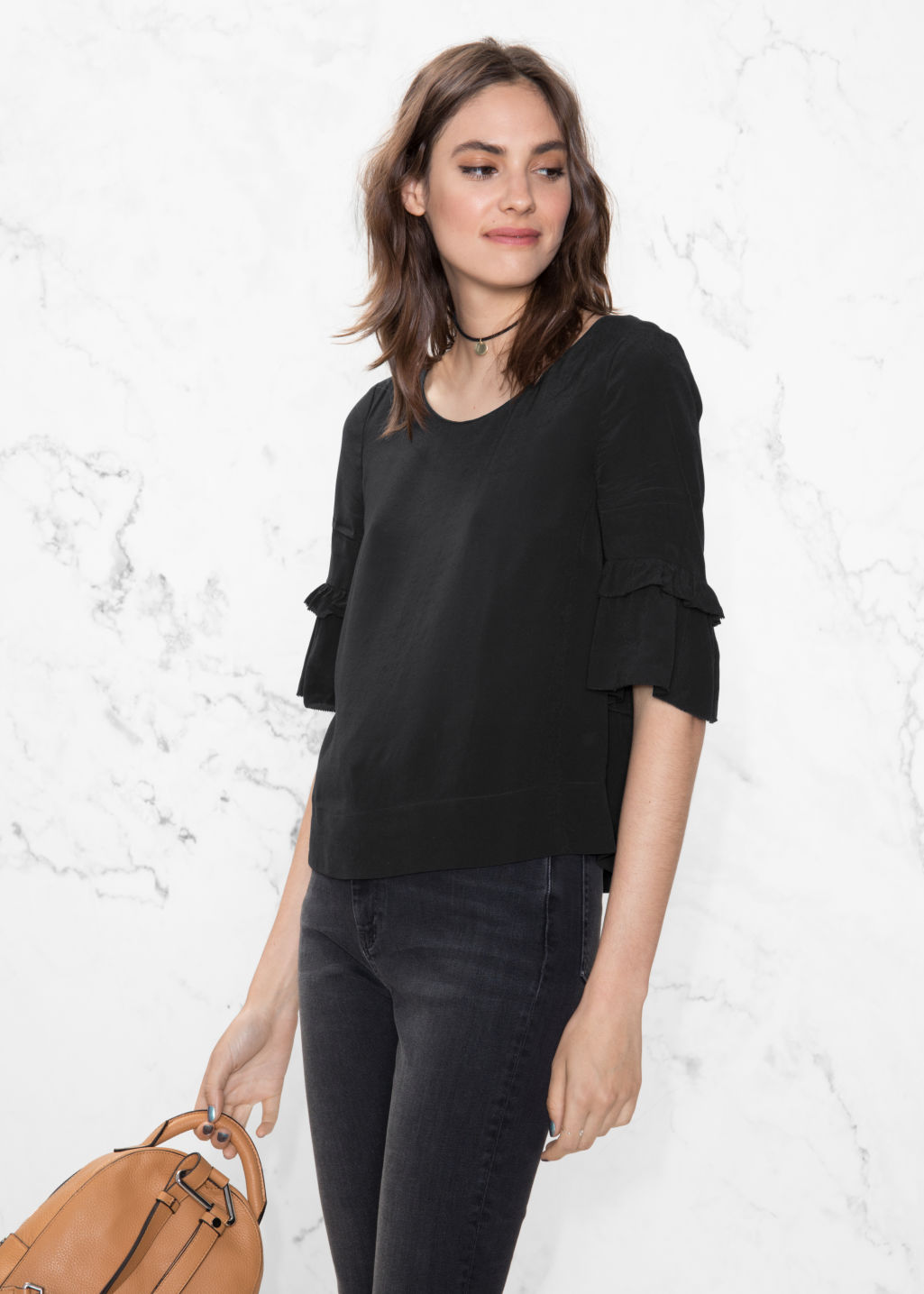 Model front image of Stories ruffle sleeves blouse in black