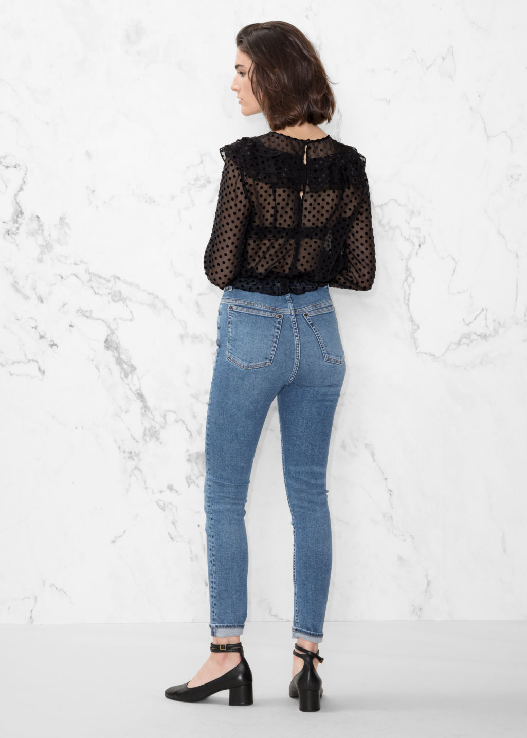 Model back image of Stories cropped high-rise jeans in blue