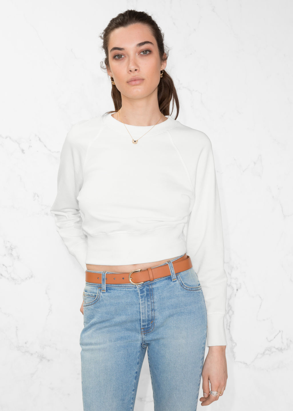 Model front image of Stories raglan sleeve sweater in white