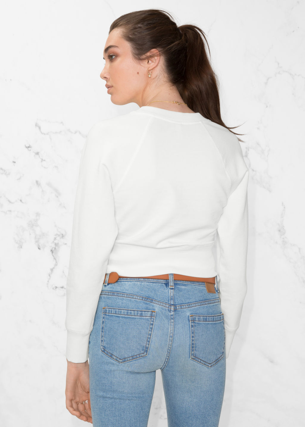Model back image of Stories raglan sleeve sweater in white