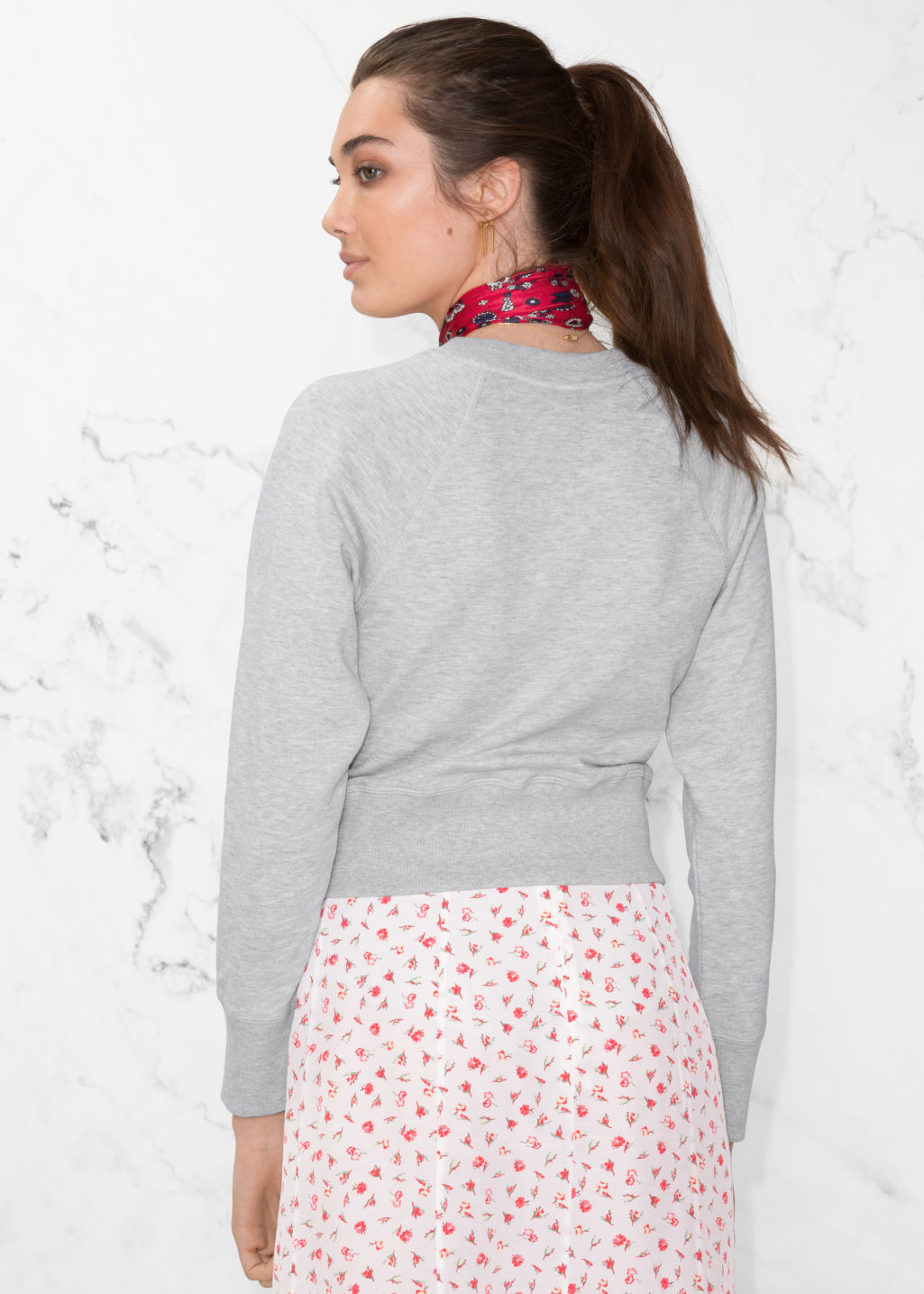 Model back image of Stories raglan sleeve sweater in grey