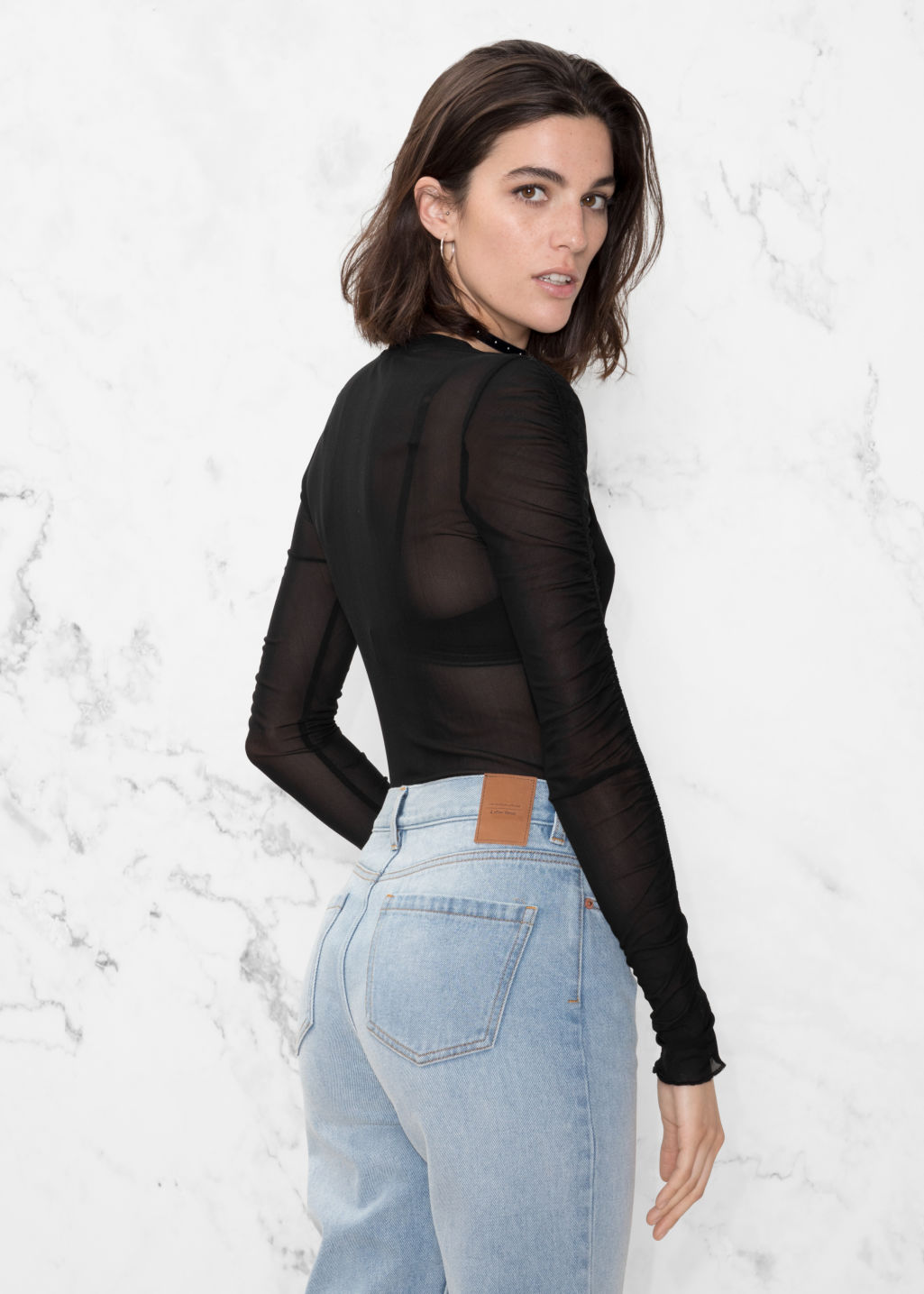 Model back image of Stories gathered sleeve top in black