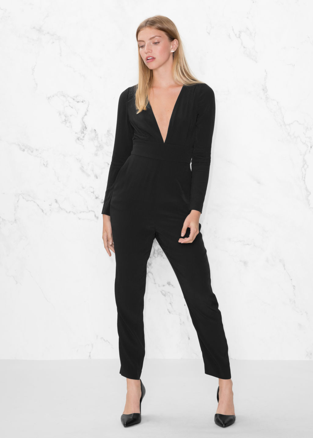 Model front image of Stories deep v jumpsuit in black