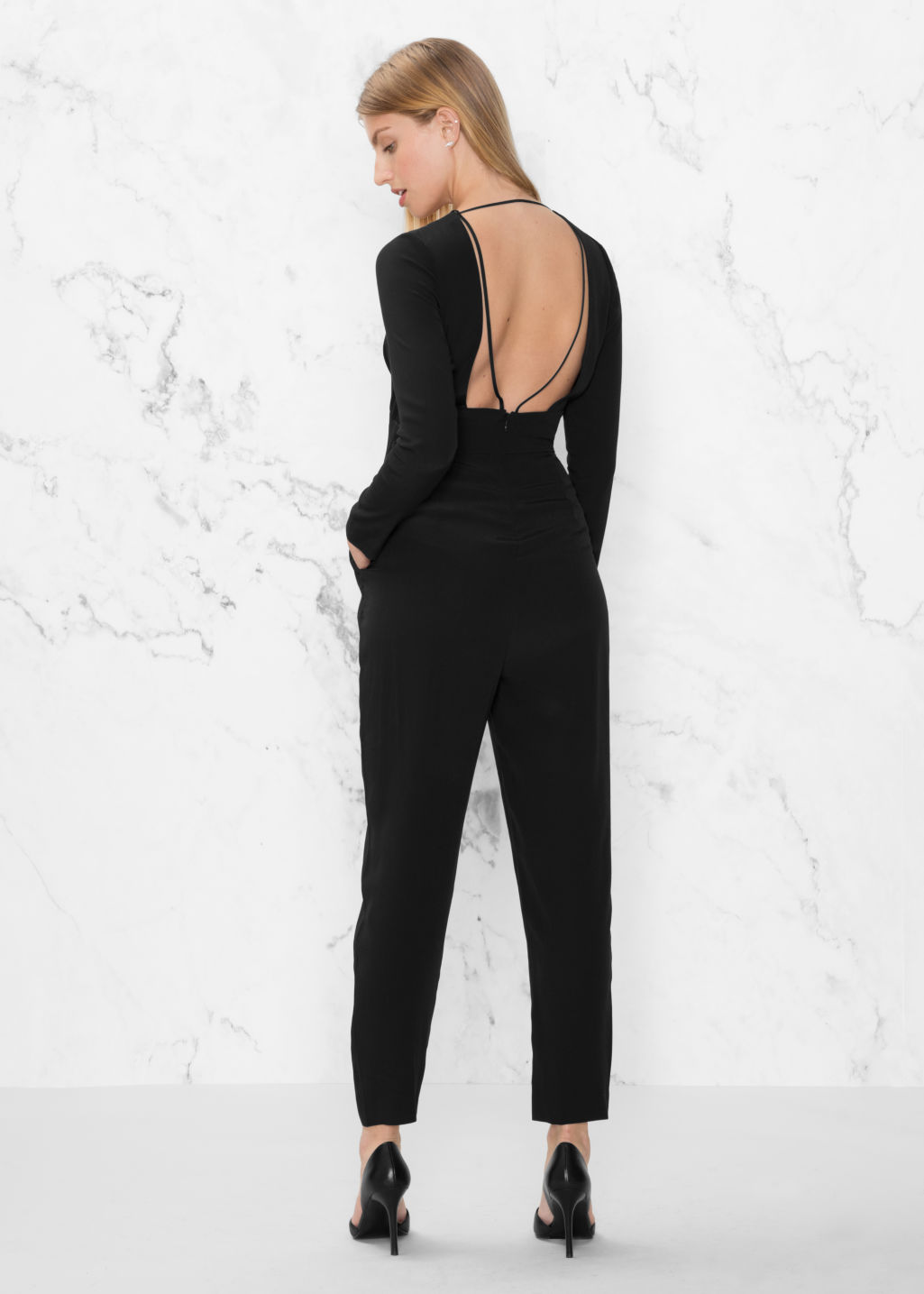 Model back image of Stories deep v jumpsuit in black