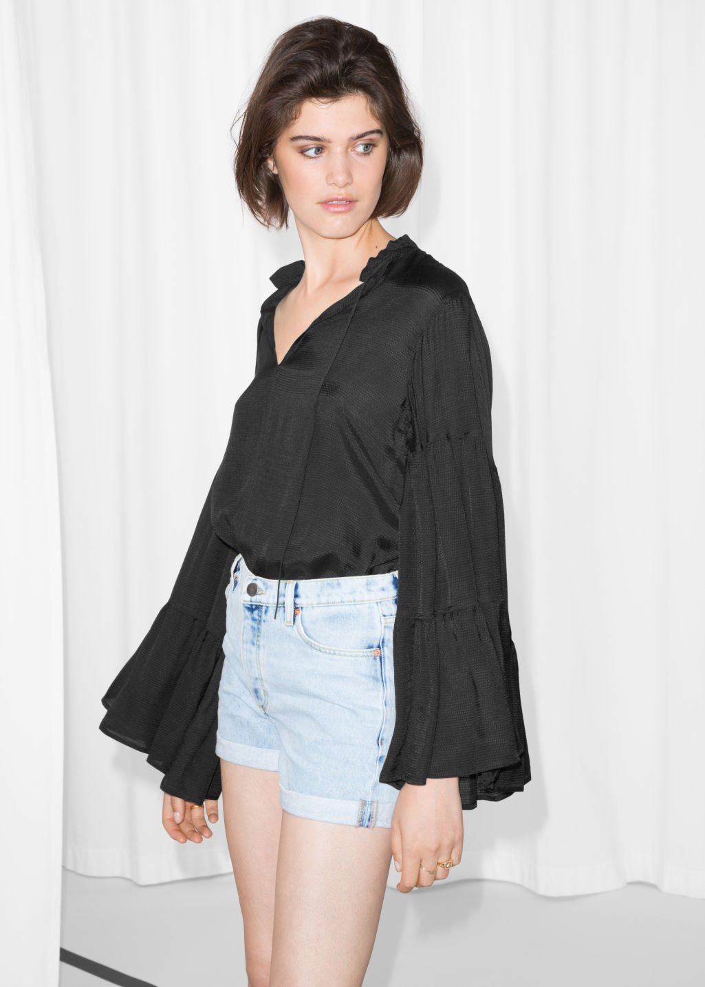 Model front image of Stories oversized sleeve blouse in black