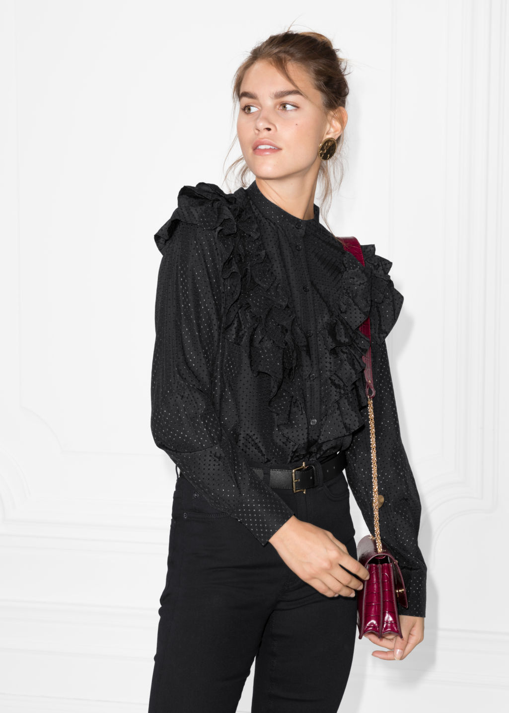 Model front image of Stories ruffle blouse  in black