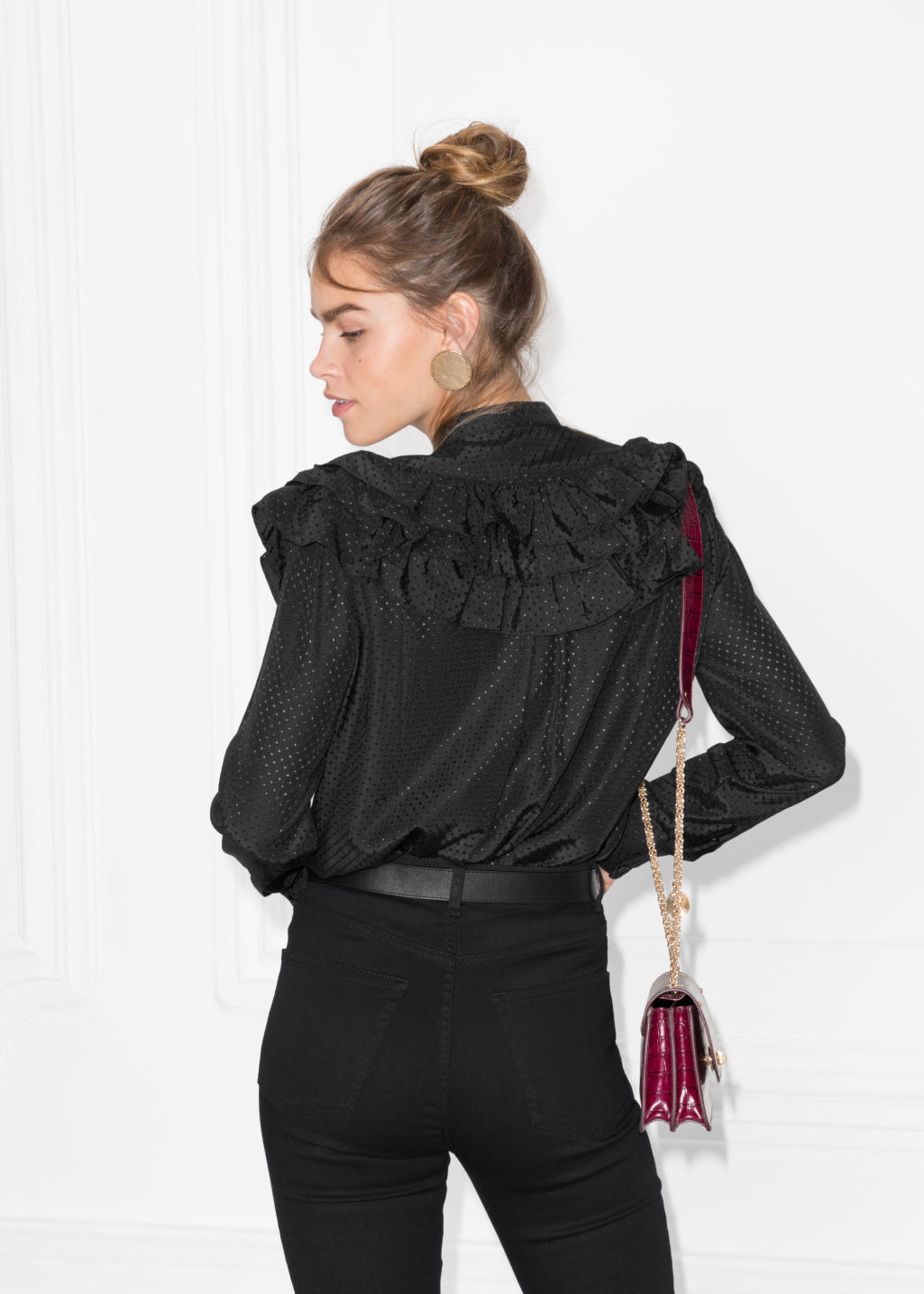 Model back image of Stories ruffle blouse  in black