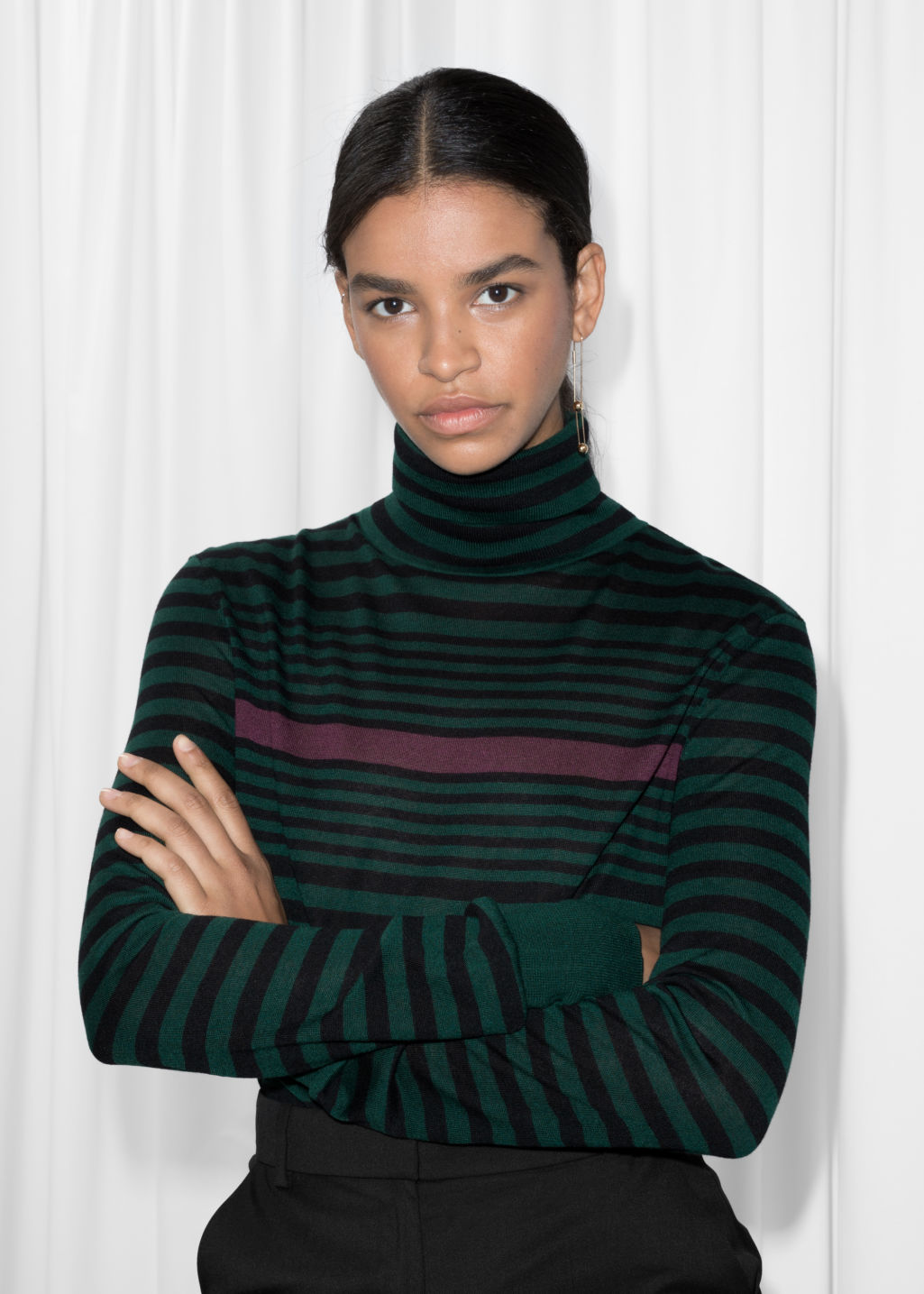 Model front image of Stories turtleneck sweater in green