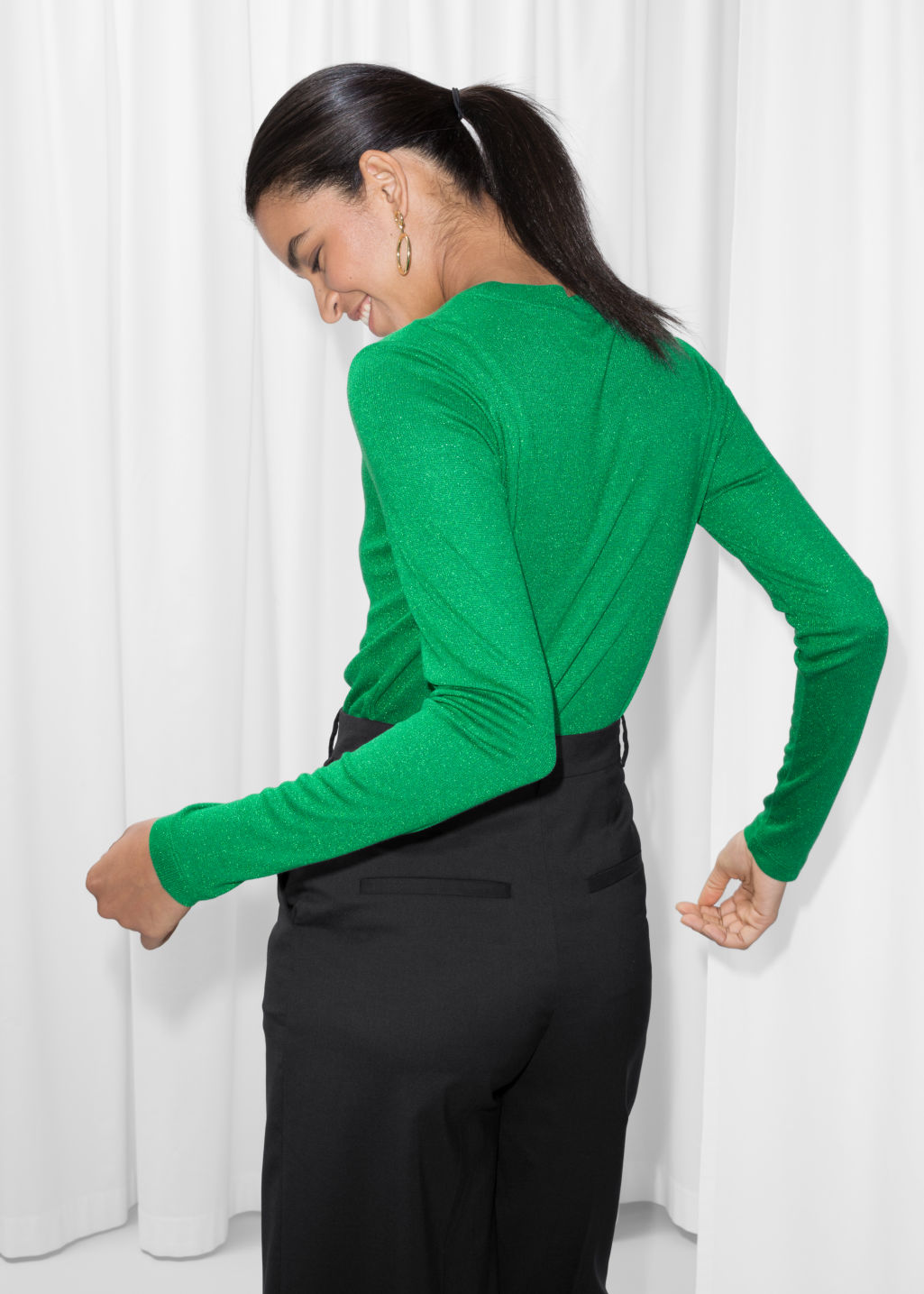 Model back image of Stories lurex top in green