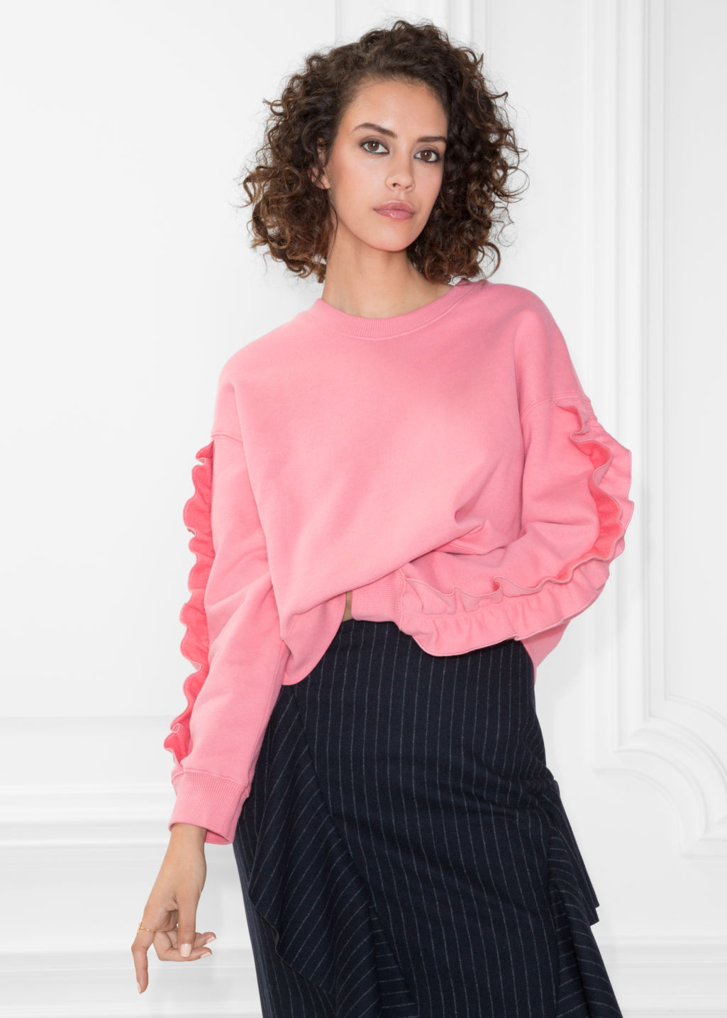 Model front image of Stories frill sleeve sweater in pink