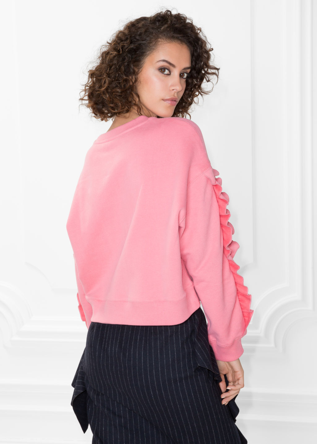 Model back image of Stories frill sleeve sweater in pink