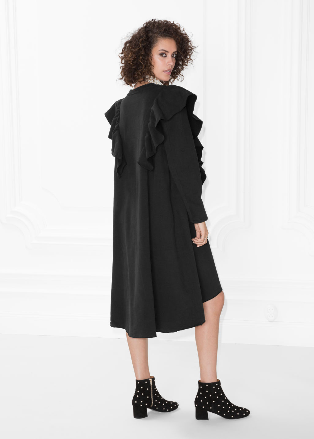 Model back image of Stories oversized frill dress in black