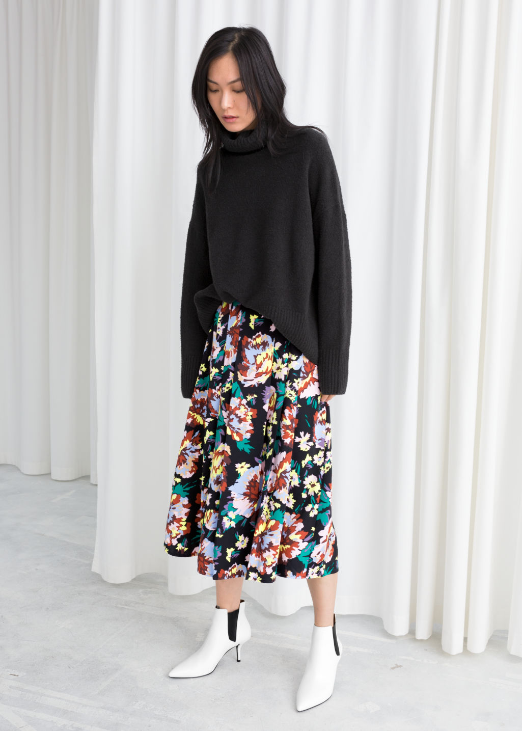 Model front image of Stories colour block pleat skirt in black
