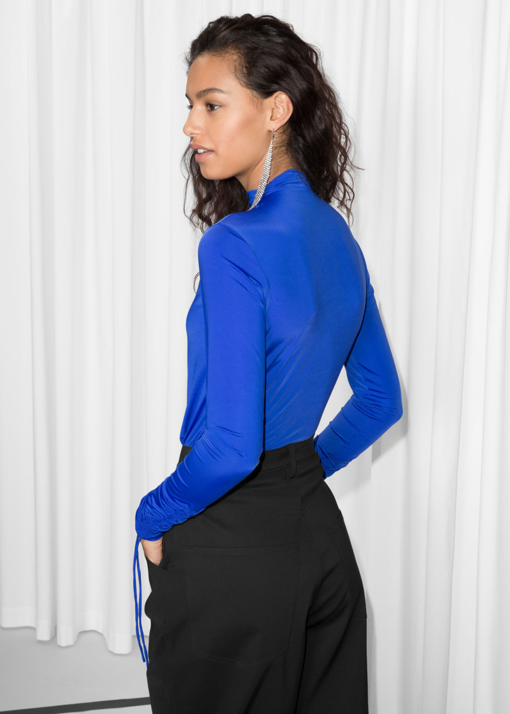 Model back image of Stories drawstring sleeve top in blue