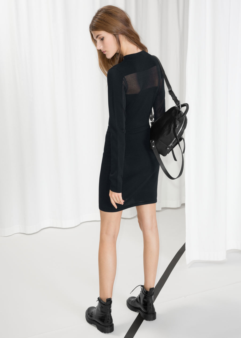 Model front image of Stories semi-sheer knit dress in black