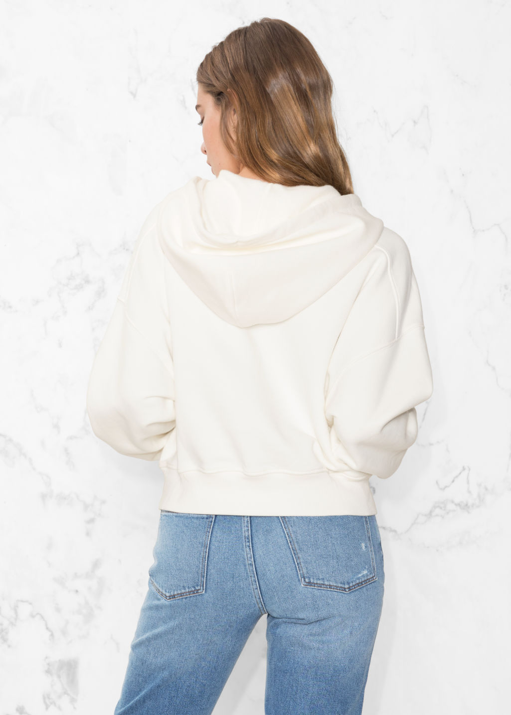 Model back image of Stories patch pocket hoodie in white