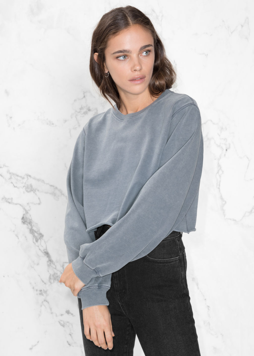Model front image of Stories crop sweater in blue