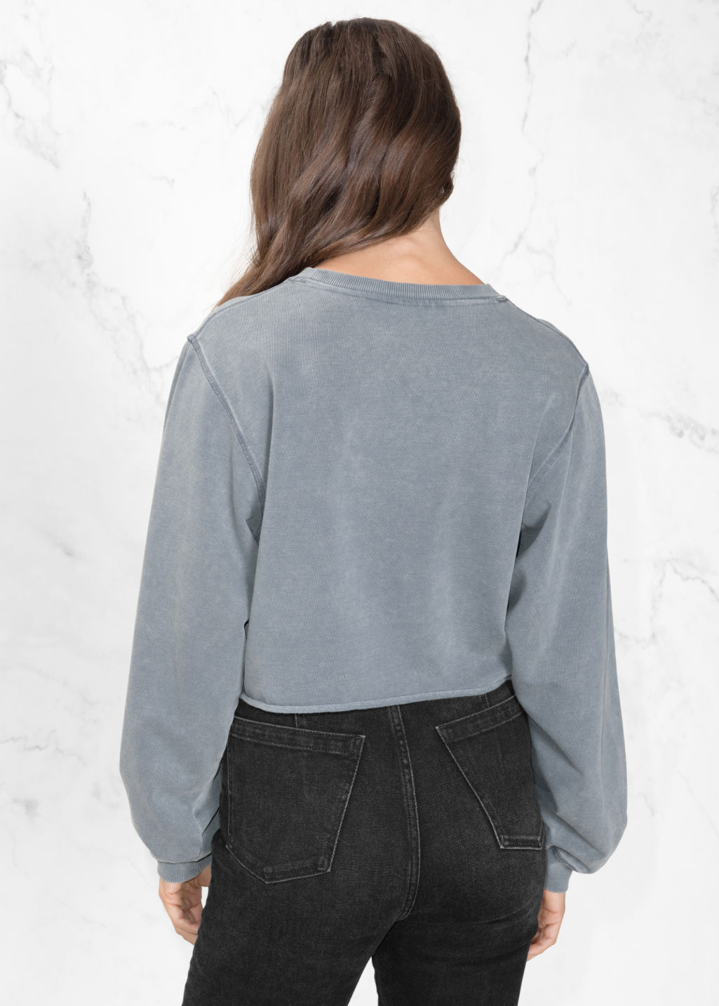 Model back image of Stories crop sweater in blue