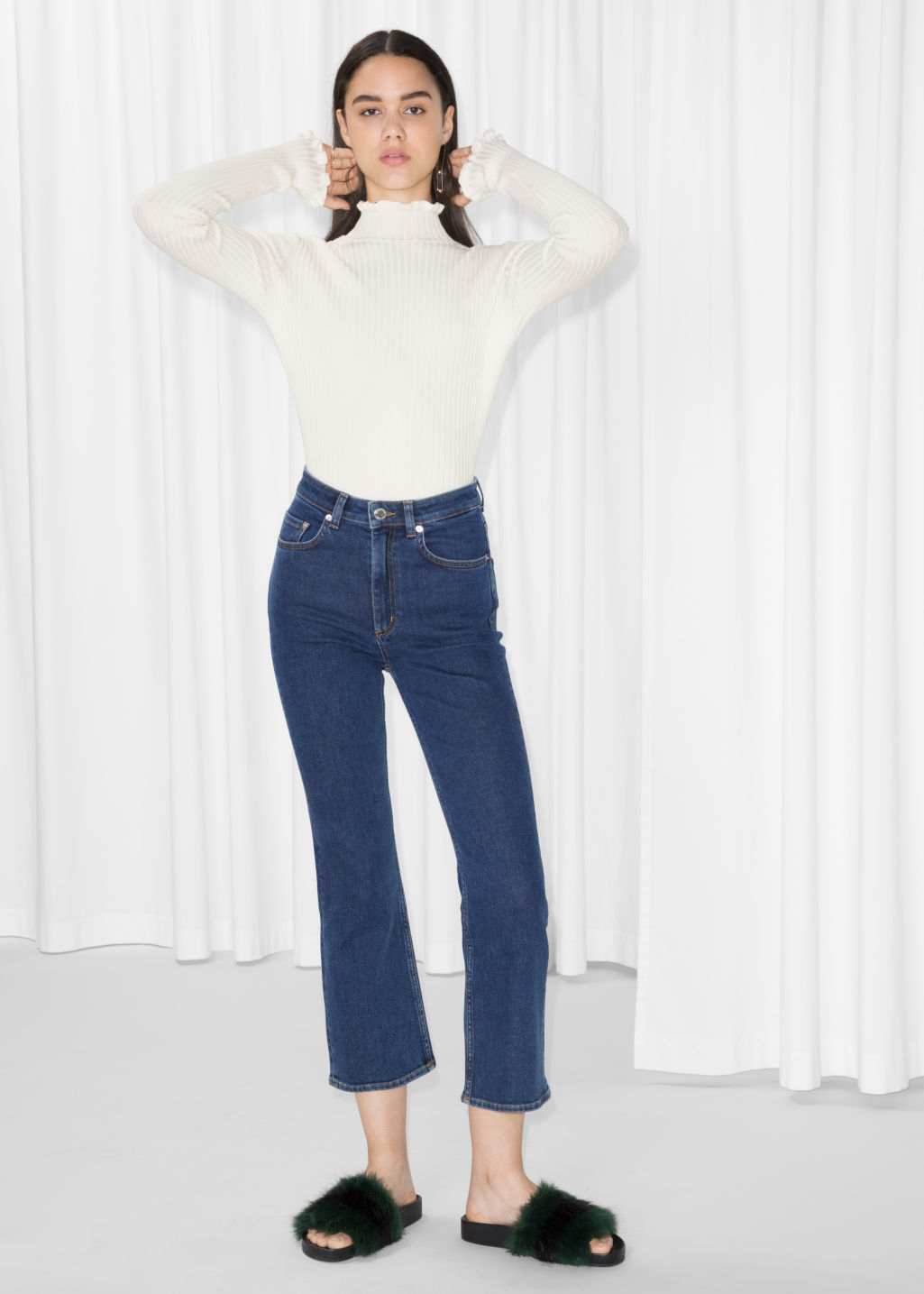Model front image of Stories flare denim jeans in blue