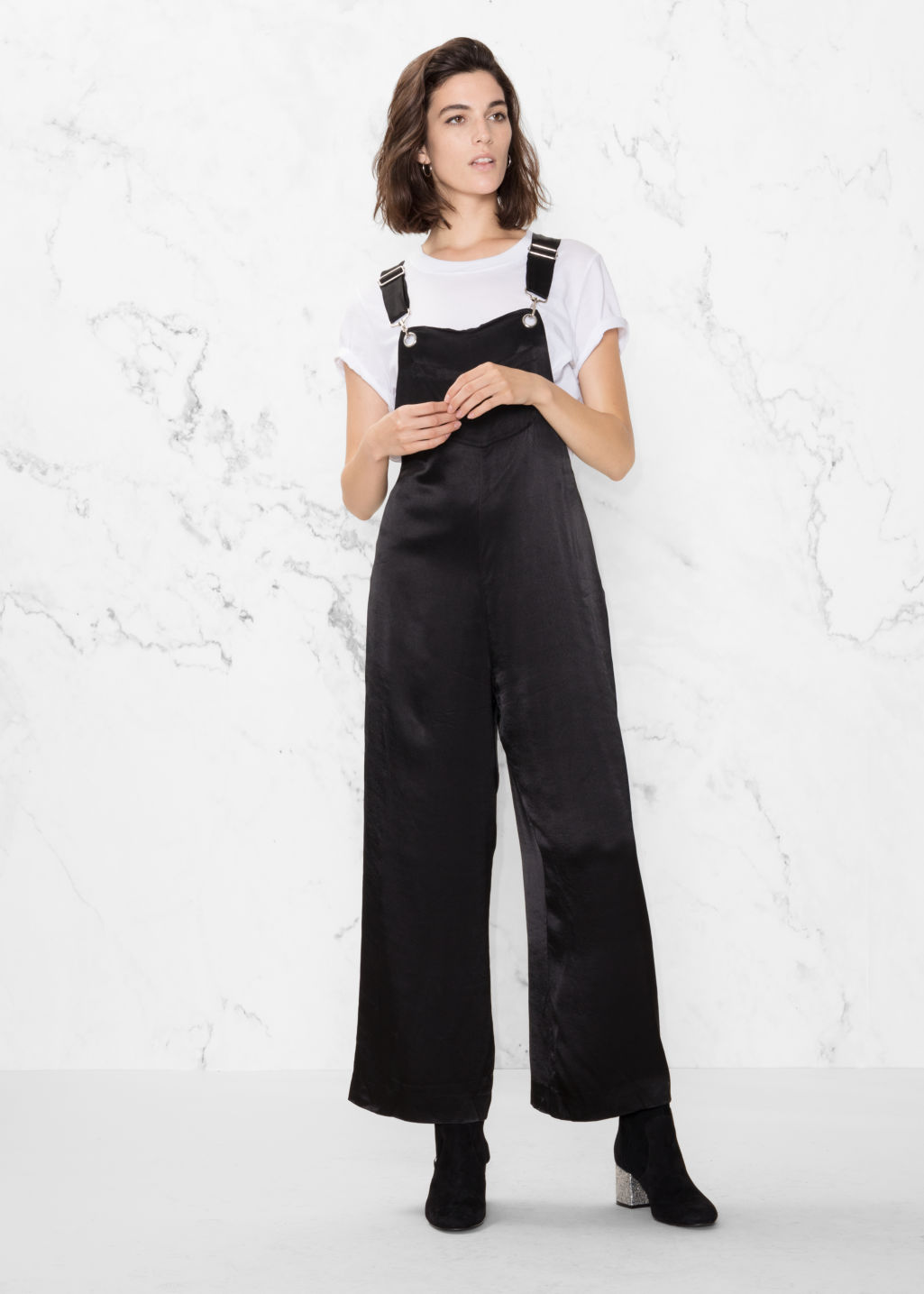 Model front image of Stories satin jumpsuit in black