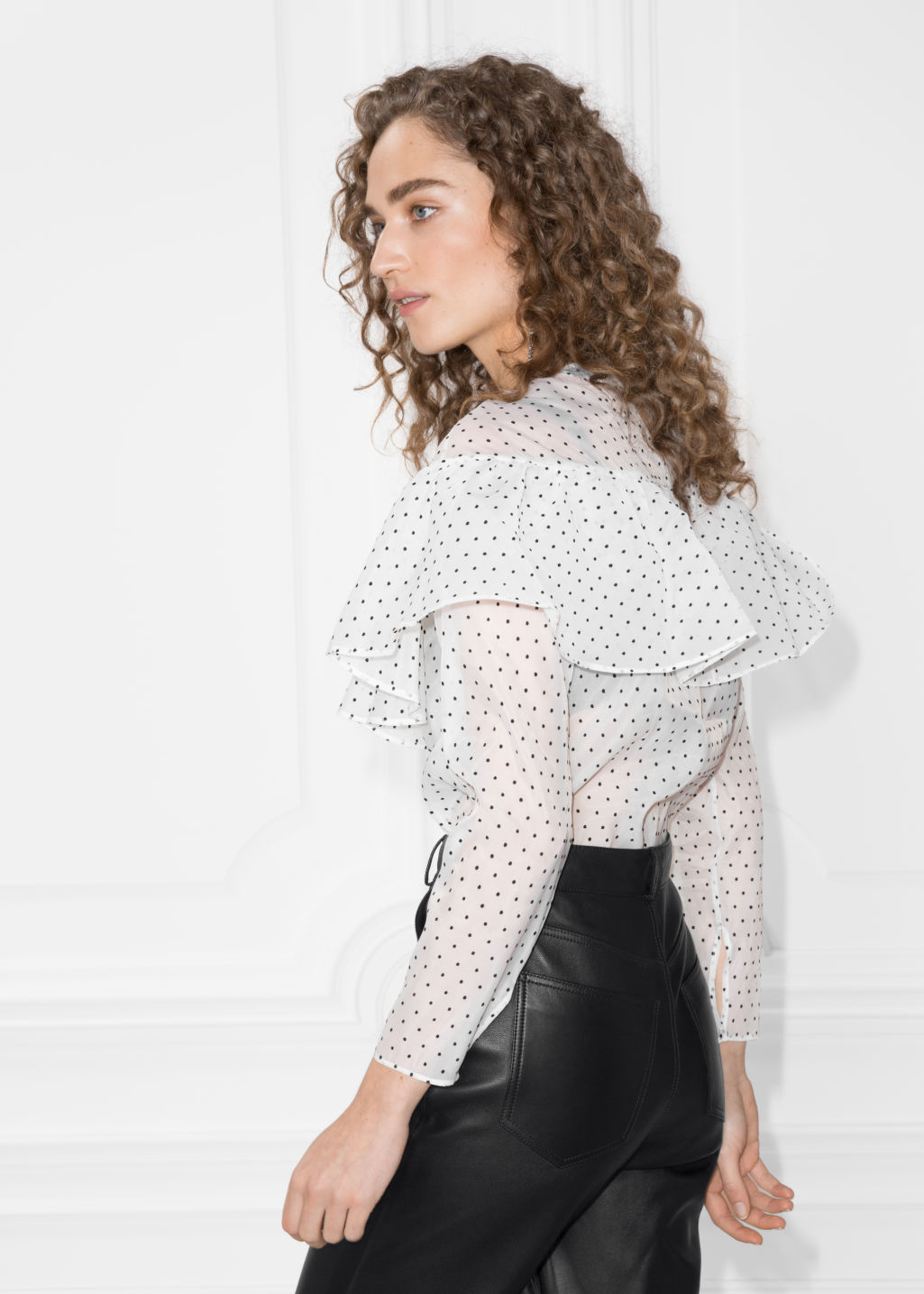 Model back image of Stories polka-dot frill blouse in white
