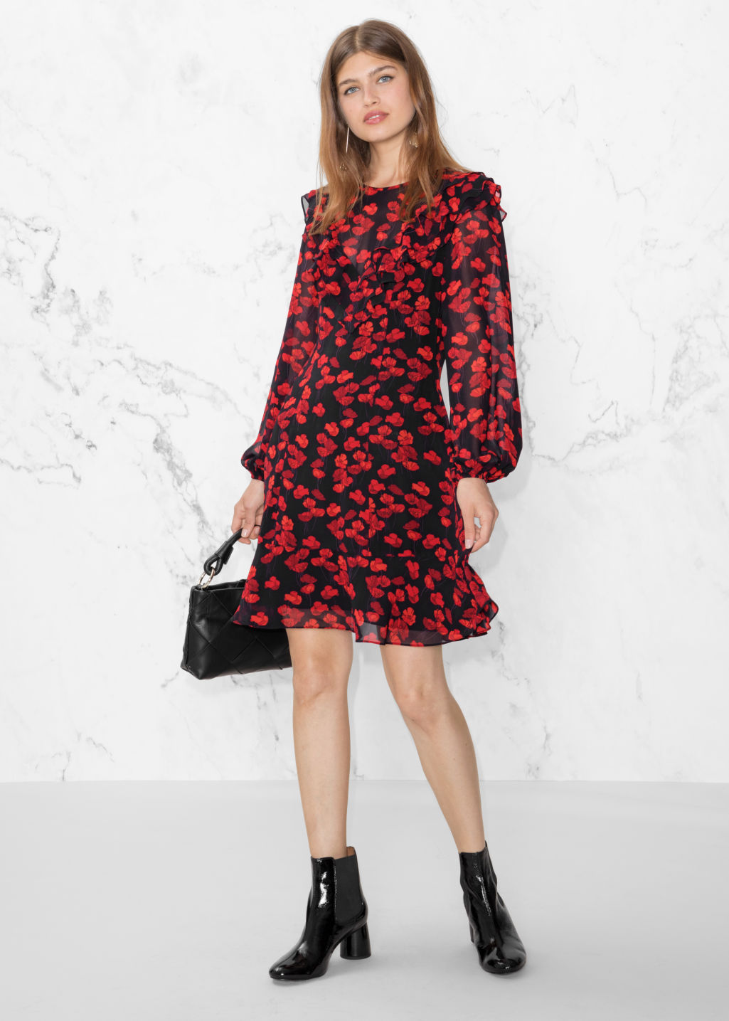 Model front image of Stories poppy print dress in black