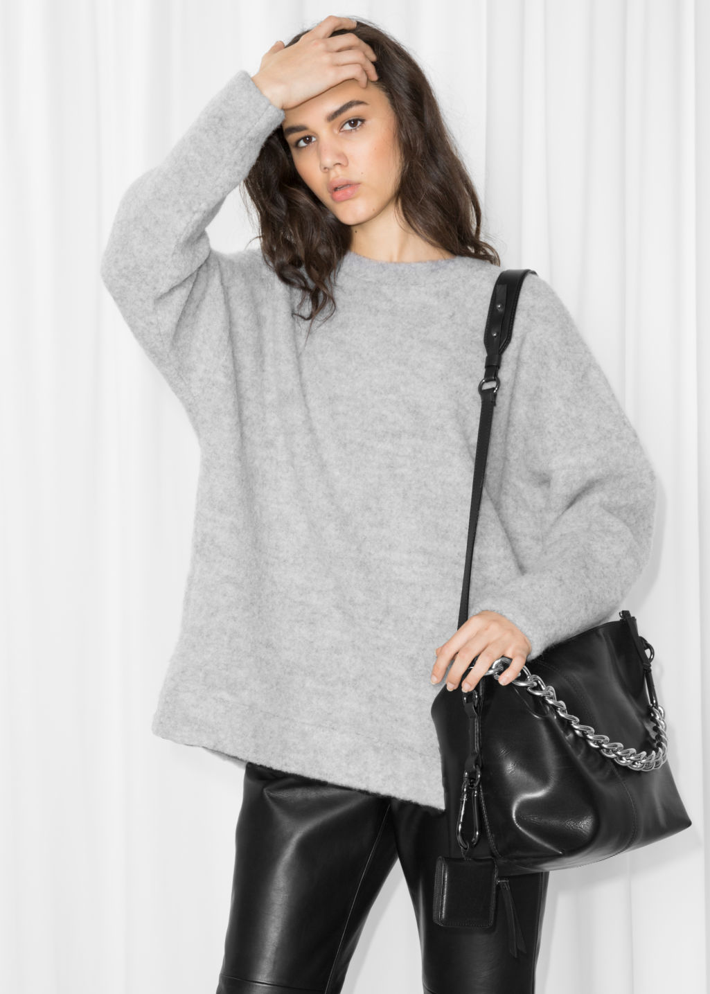 Model front image of Stories oversized wool sweater in grey
