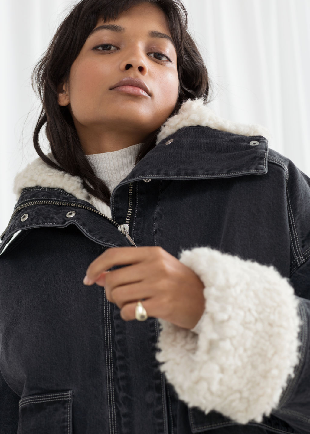 Model front image of Stories denim faux shearling jacket in grey