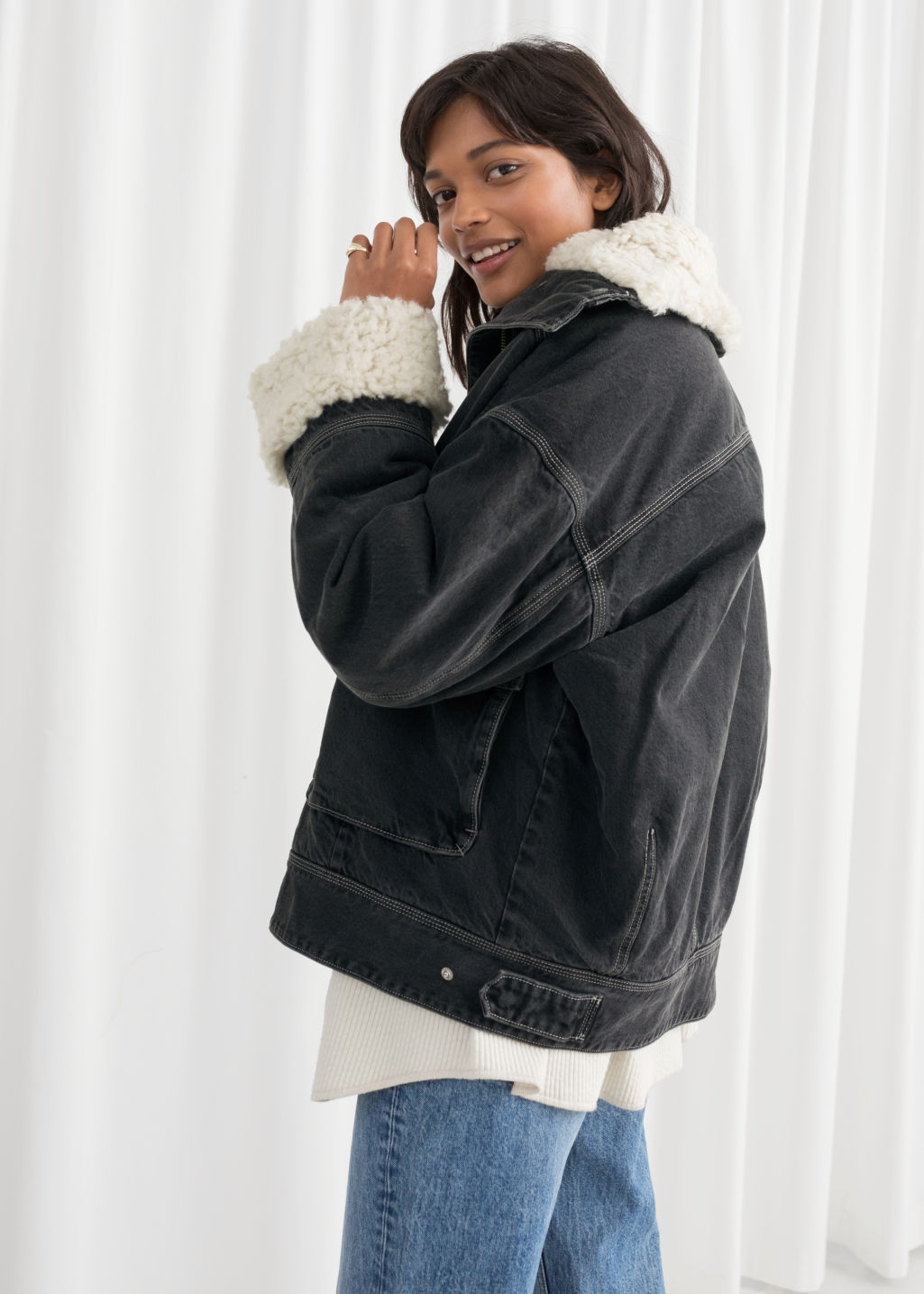 Model back image of Stories denim faux shearling jacket in grey