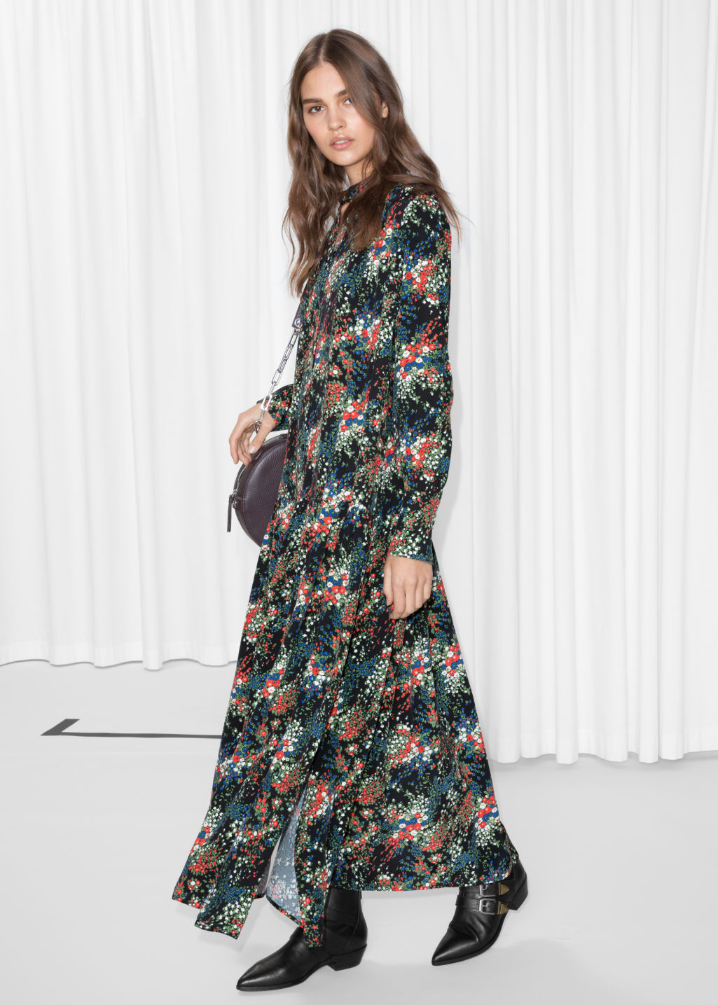 Model front image of Stories oversized printed maxi dress in black