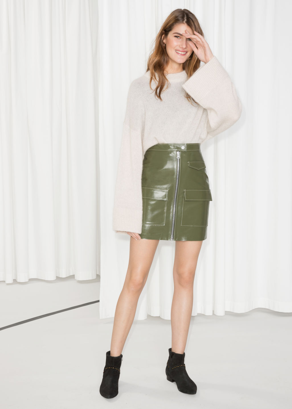 Model front image of Stories utilitarian patent leather skirt in green
