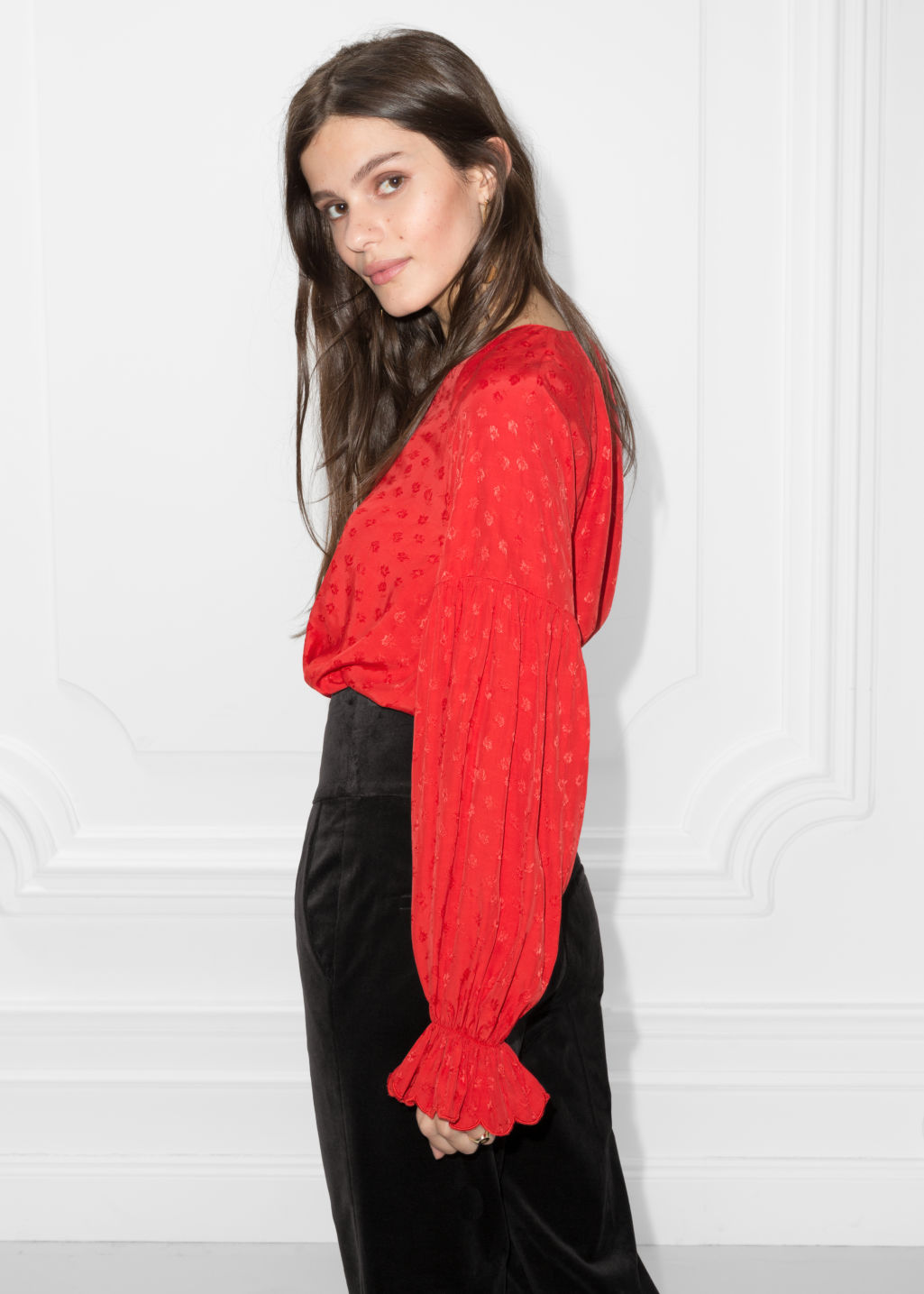 Model back image of Stories v-neck blouse with trumpet sleeves in red