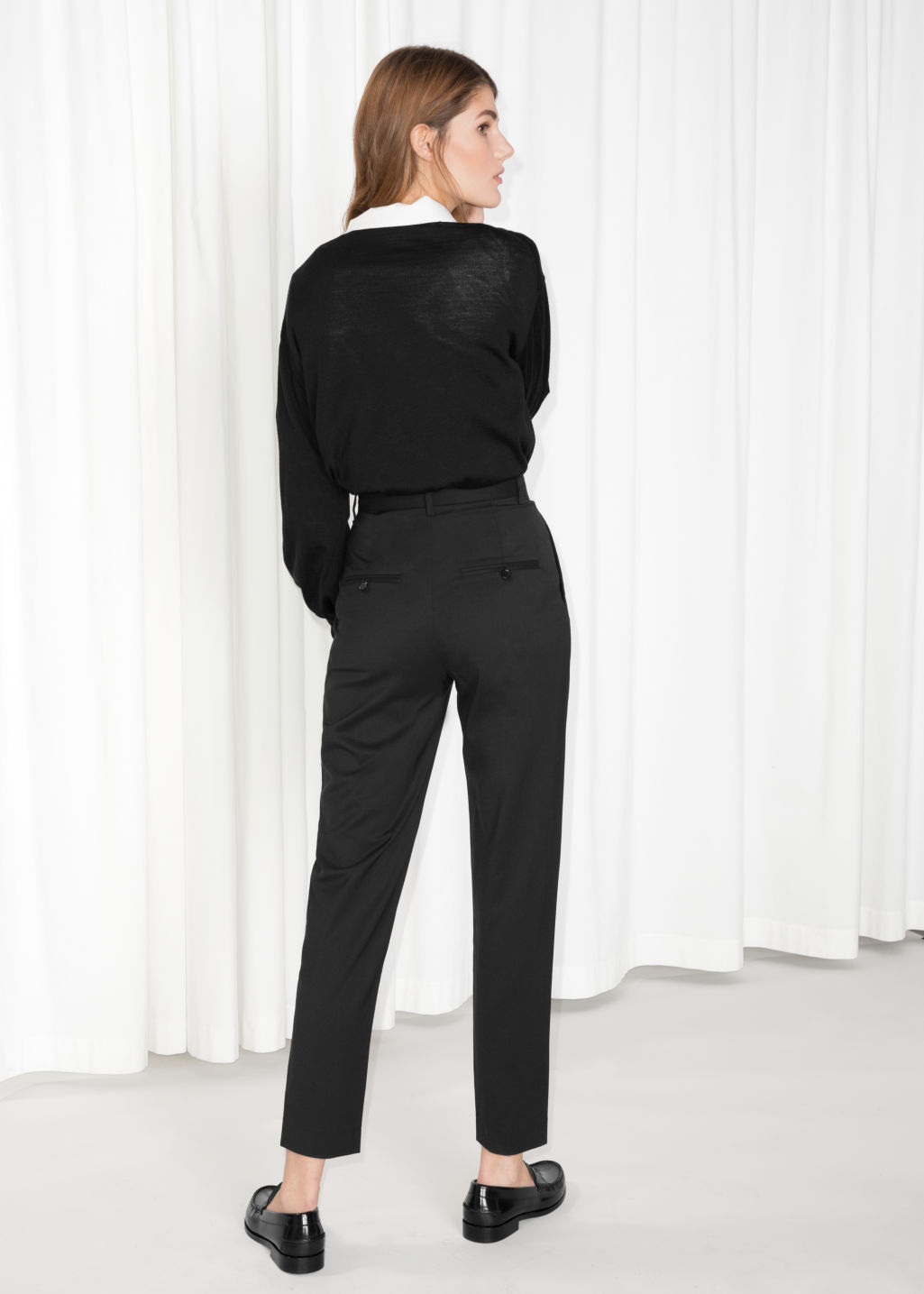 Model back image of Stories high waisted tapered trousers in black