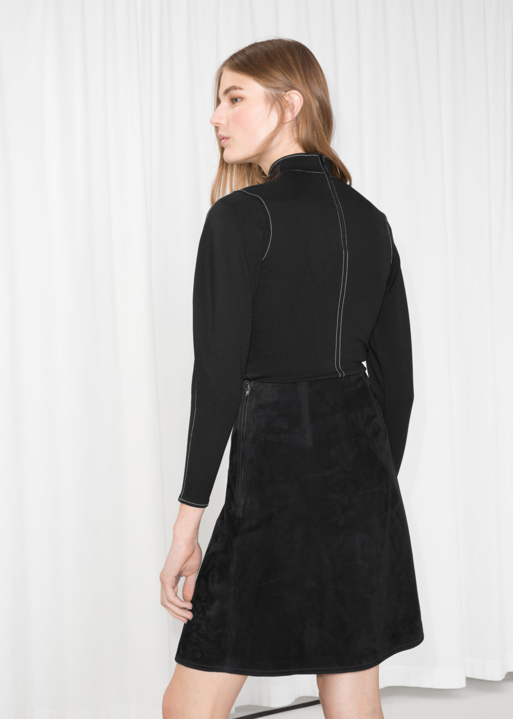 Model back image of Stories leather button stud skirt in black
