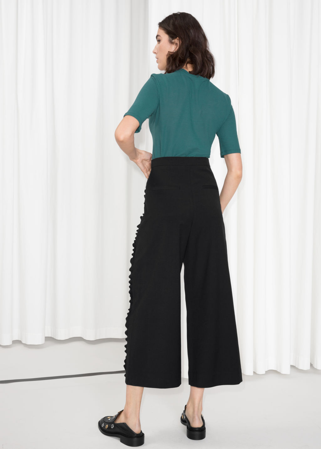 Model back image of Stories ruffle tuxedo stripe culottes  in black