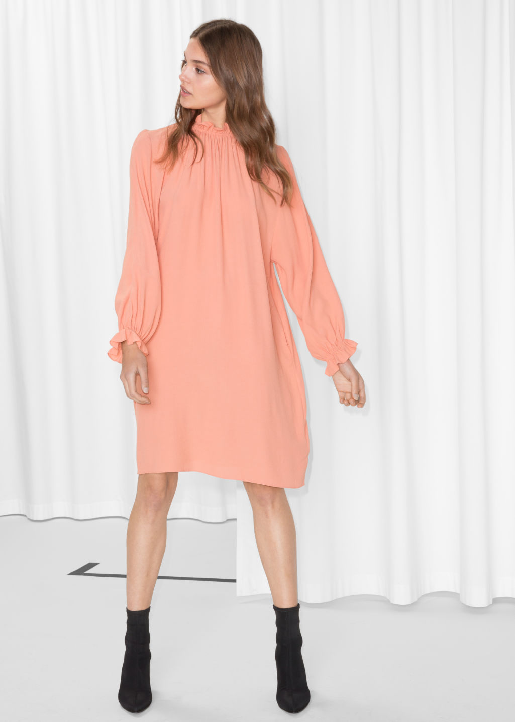 Model front image of Stories high neck frill dress in orange